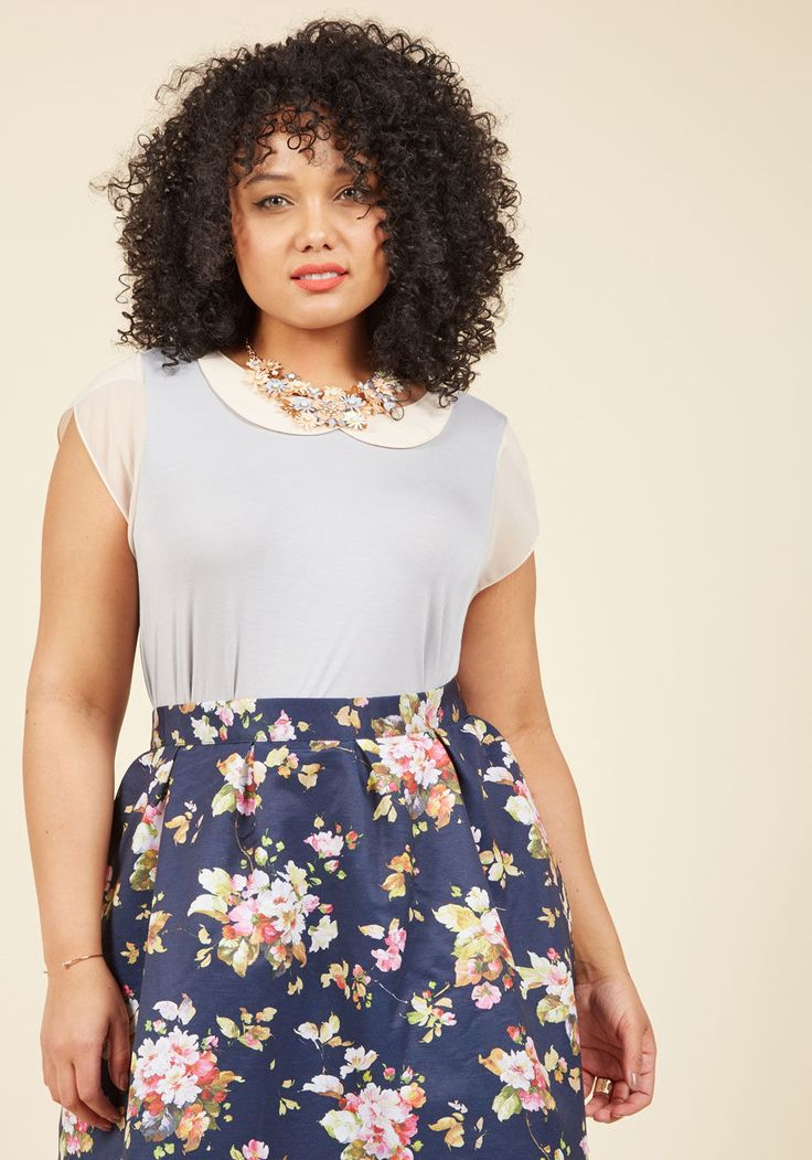 <p>Your uplifting energy leaves colleagues curious over about how you stay so sprightly. Turns out, your secret is styling this grey top from our ModCloth namesake label, for its lapped collar and matching cap sleeves - colored in a lovely cream hue - fill you with endless excitement!</p>