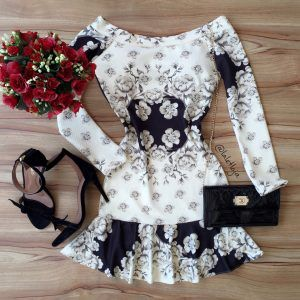 Black and white off the shoulder mini dress with long sleeves
