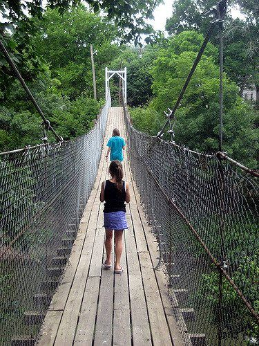 Located in Pawhuska, Oklahoma, the Pawhuska Swinging Bridge was built in 1926 and was the only way to get into town during high waters. The bridge crosses over Bird Creek with its crickety, old wood planks and chain link sides.
