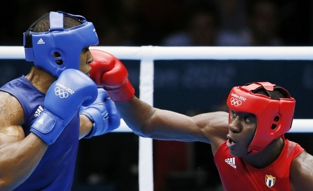 Erislandy Savon Cotilla (R) of Cuba defends against Anthony Joshua (L) of Great Britan during their  round of 16 Super-heavyweight (91+kg) boxing match of the  London 2012 Olympics at the ExCel Arena  August 1, 2012 in London. In a major upset, Joshua defeated Savon Cotilla with a 17-16 points decision.