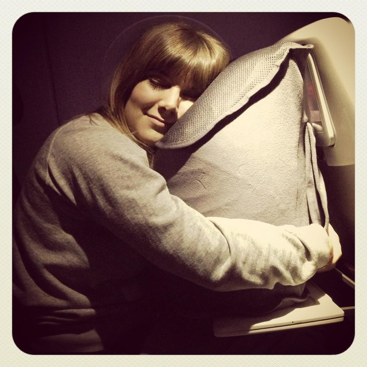 Julie demonstrating the comfy travel pillow