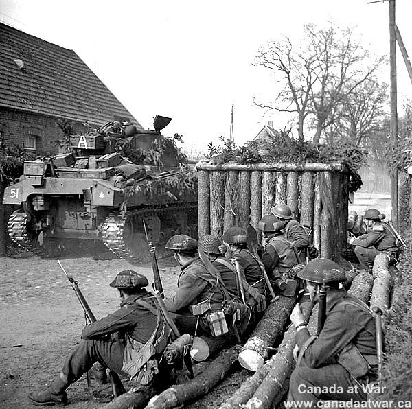 Infantrymen of the Lincoln and Welland Regiment and a Sherman tank of the 4th…