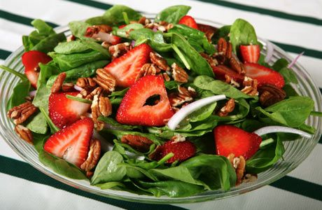 Salad with Strawberries and Walnuts.   To make a smaller quantity I just used a bag of baby mixed greens/baby spinach....  Delish!!