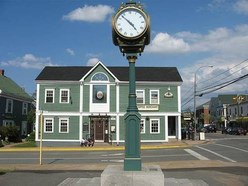 Town Clock and Library Pub in Wolfville, Nova Scotia  by Alan Riddle