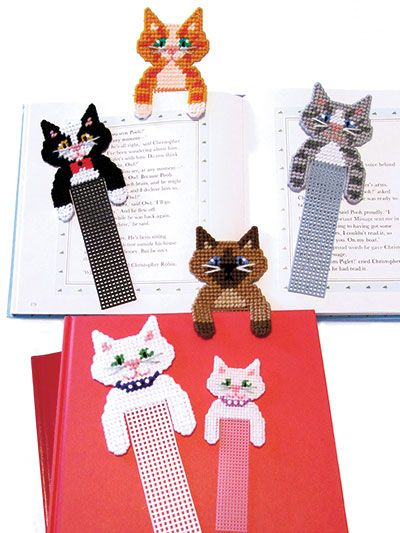 "A perfect quick-to-stitch gift for all ages and occasions, these adorable kitties are functional and sweet at the same time! Made with 10- or 7-count plastic canvas using sport- or worsted-weight yarns.  Finished sizes:  Large bookmark: 3""W x 8 ..."