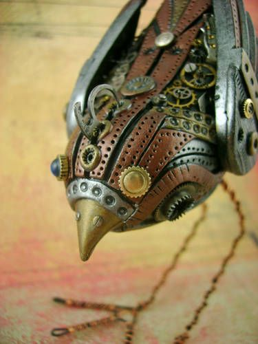 Steampunk bird created from poylmer clay and watch parts by monsterkookies. monsterkookies.com