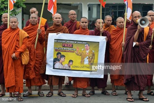 Buddhist monks from Myanmar hold a poster as they demonstrate... #witheridge: Buddhist monks from Myanmar hold a poster as… #witheridge