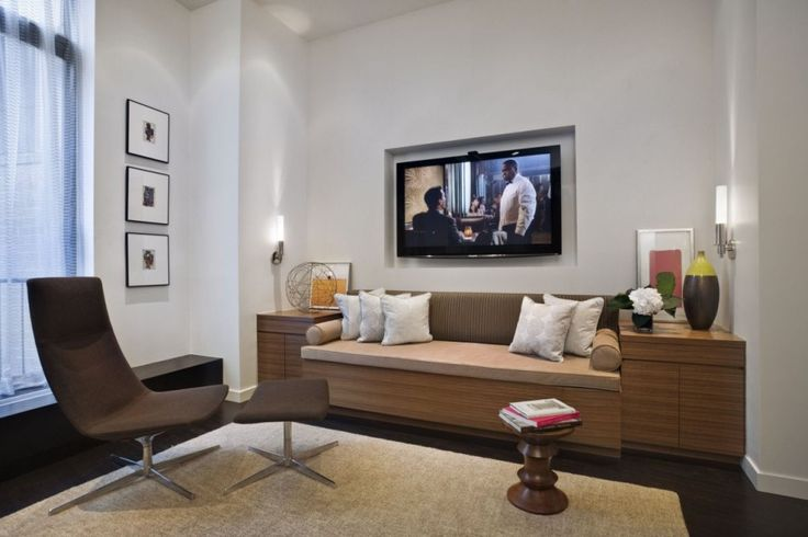 Interior Modern Apartment Design: Movie Shaker Modern Apartment With Brown Swivel Chair Plus Footstool And Combination Material Laminate Furniture Set And Twin Willowy Metal Frame Wall Lamps