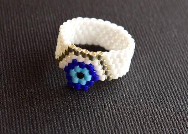 Handmade item.Beaded ring.Peyote Ring.Evil eye/ Flower.Delica Beads.Mariella's Code. by mariellascode on Etsy