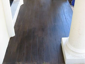 Hardwood flooring look with the strength and durability of a stained concrete floor.  Mesa Brown Chromastain over McKrete Wood Grain.