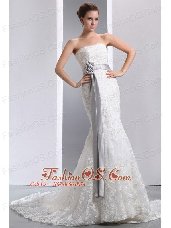 Luxurious Mermaid Strapless Sash Wedding Dress Court Train Taffeta and Lace  http://www.fashionos.com  http://www.facebook.com/weddingdress.fashionos.us  Feel special on your special day in this wedding dress. This strapless gown has a structured bust and an empire waist highlighted with floral waistband. The contrasting ribbon wraps the waist and a lovely hand-made flower sits at one side.