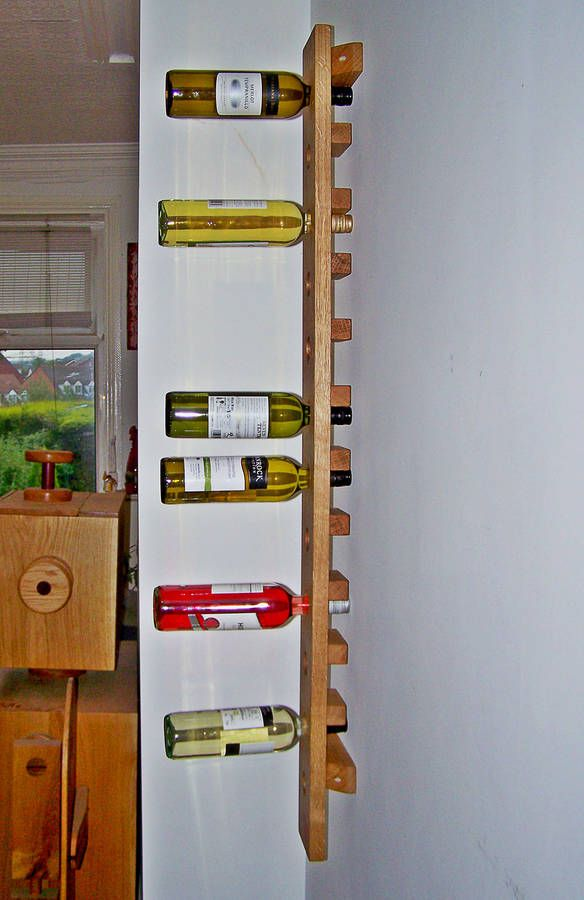 wine rack wall mounted handmade in solid oak long by red thumb print   notonthehighstreet.com
