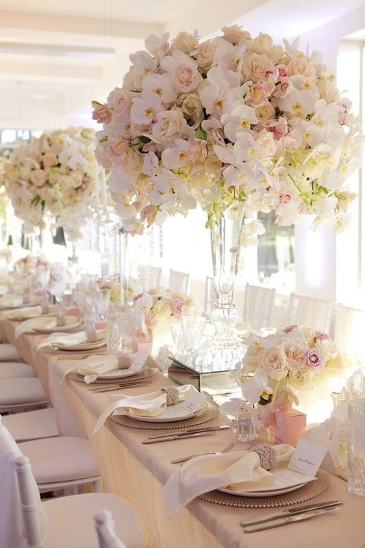 Stunning, tall ivory, white and light pink full flower centerpieces displayed on tall glass vessels {Bayfront Floral and Event Design}