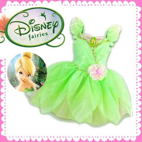 Authentic Disney Deluxe Tinkerbell dress Glittering Disney Tinkerbell dress Costume for little girls This deluxe design is no longer available at the store... Accessories SOLD SEPARATELY ( Tinkerbell goody bag, Tinkerbell wings and Tinkerbell shoes) all bought from Disney Store. Slightly used. Still perfect for princess themed parties or Halloween . Disney Authentic Dresses