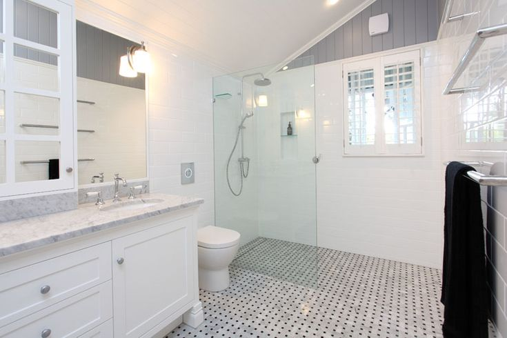 We just completed this gorgeous ensuite. We used a basketweave marble tile on the floor with a white subway tile on the wall, astra walker taps and a custom made vanity. Its fresh and suits the style of the Queenslander home perfectly.