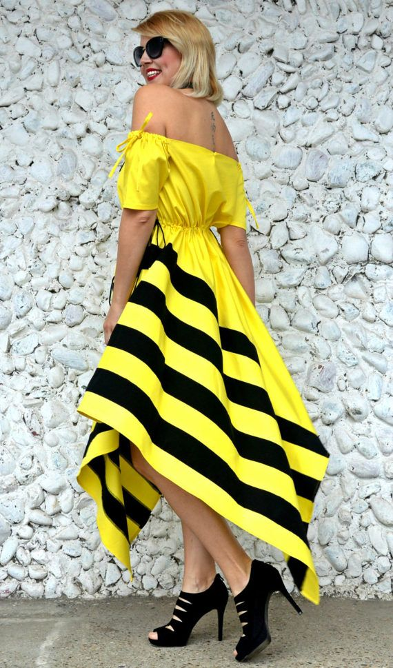 Extravagant lemon yellow dress with black stripes made of pure cotton that will jazz up your wardrobe. The strap around the neck is made of genuine leather. Playful, stylish and colorful, this bumble bee dress will steal the spotlight this summer! Very comfortable and light, this asymmetrical dress is so fun to wear, being the queen of every occasion! *from the new The French Kiss collection  Material: 95% cotton, 5% elastane / black strap: 100% genuine leather  Care instructions: Wash a...