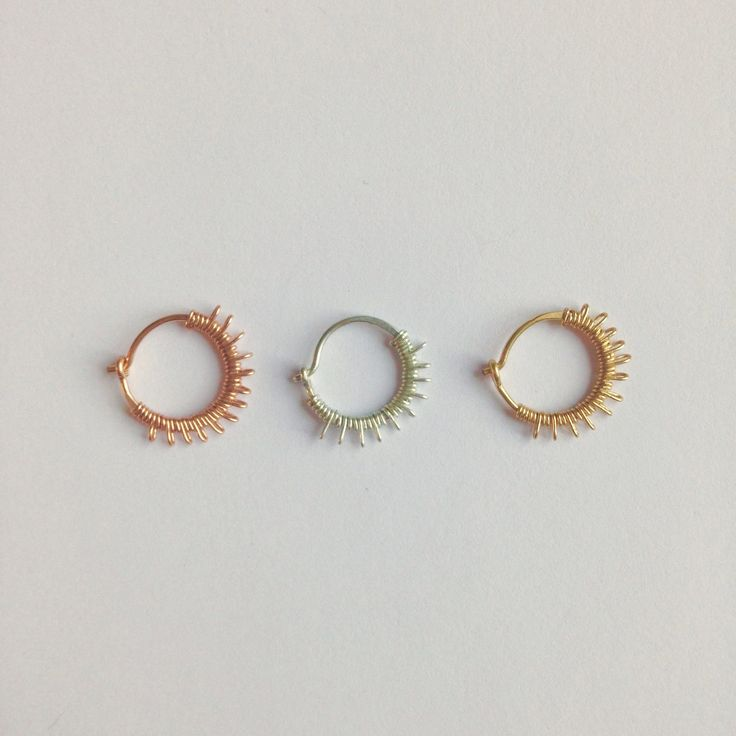 """A dainty little nose ring full of sparkle and sun rays. Lalita literally means """"Playful and Charming"""". 22 gauge ring in sterling silver, yellow gold filled and rose gold filled. The inside dimension i"""