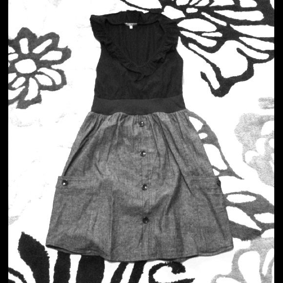 Black and grey summer dress Sleeveless black and grey summer dress. It's hard to see but there's a ruffle on the neckline. Super cute for summer. Black buttons down the front and on the sleeves. Dresses