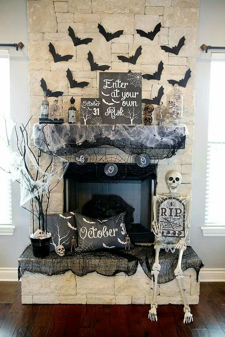 halloween mantel decorations spooky mantle decor with skeleton flying bats apothecary jars beautiful cream and black colors