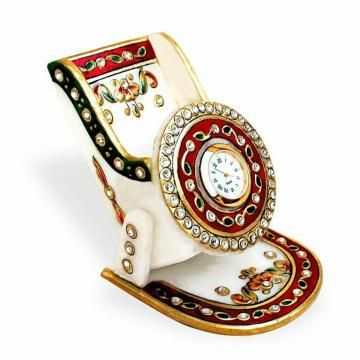 This mobile stand with antique work is a master piece in marble. Its beautiful shape, designs and embossing work to add brilliance to your house décor. This decorative mobile holder with good quality of clock, these are worthy item gift for home, office, desktop and gifting purpose.