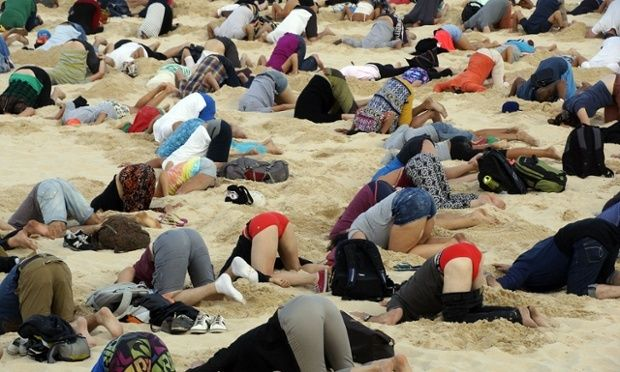 Australians burying their heads in the sands to send a message to Prime Minister Tony Abbott about the dangers of climate change. Slowing population growth could provide 16–29% of the emissions reductions necessary by 2050 to avoid dangerous climate change.