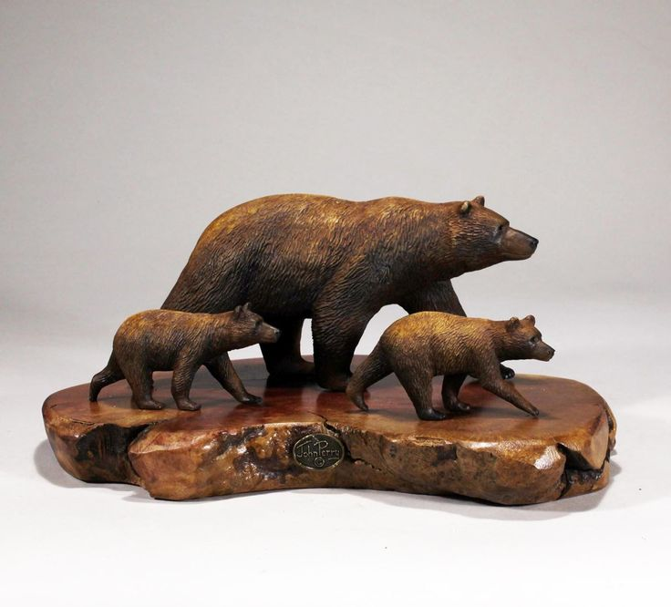 Grizzly Bear Mother and Two Cubs Sculpture from John Perry Decor 7in Long. This Grizzly Bear mother and two cub are hand molded from durable polyurethane resin and hand painted. The mother bear is about 7 inches long. The overall piece, with its polished burLwood slab, is about 9 inches long and 5 inches high. PLEASE NOTE: the photos are of illustrative samples. Each burl slab is unique, so the one you will receive will be different but similar in size and comparable in beauty. It is…