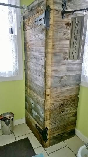 Bi- Fold Screen created from reclaimed fence wood to hide water heater in laundry room.  Would be good for the basement