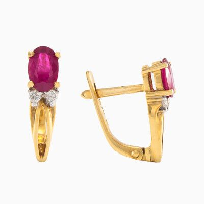 These earrings showcase the perfect combination of 18k yellow gold and natural ruby with total weight 1.08ct. Accented by 4 round diamonds with total weight 0.20ct, what creating an alluring look.