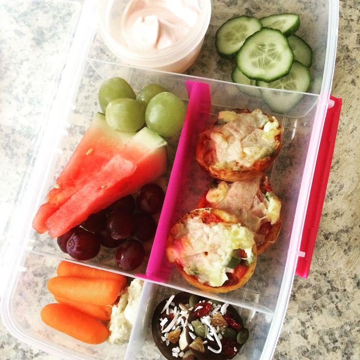 Lunch box idea : Strawberry yoghurt  Sliced cucumber Green grapes  Watermelon  Red grapes  Baby carrots & hummus  Mini pizzas  Dark chocolate scroggin bite