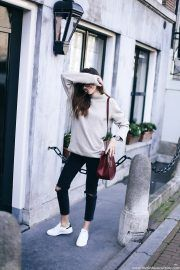 Cropped jeans are the perfect choice for a practical summer style. Beatrice Gutu pairs cropped, distressed black jeans with a simple beige sweater and sneakers for an awesome and achievable style. Sweater: Zara Man, Jeans: Asos, Sneakers: Adidas.