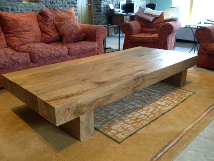 this long large oak coffee table has a table top made from 4 solid oak beams