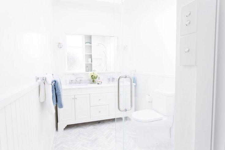 Marble herringbone floor l White bathroom l Hampton bathroom l Classic luxe bathroom l Reno Rumble Week 3 Full House Reveal l Photos