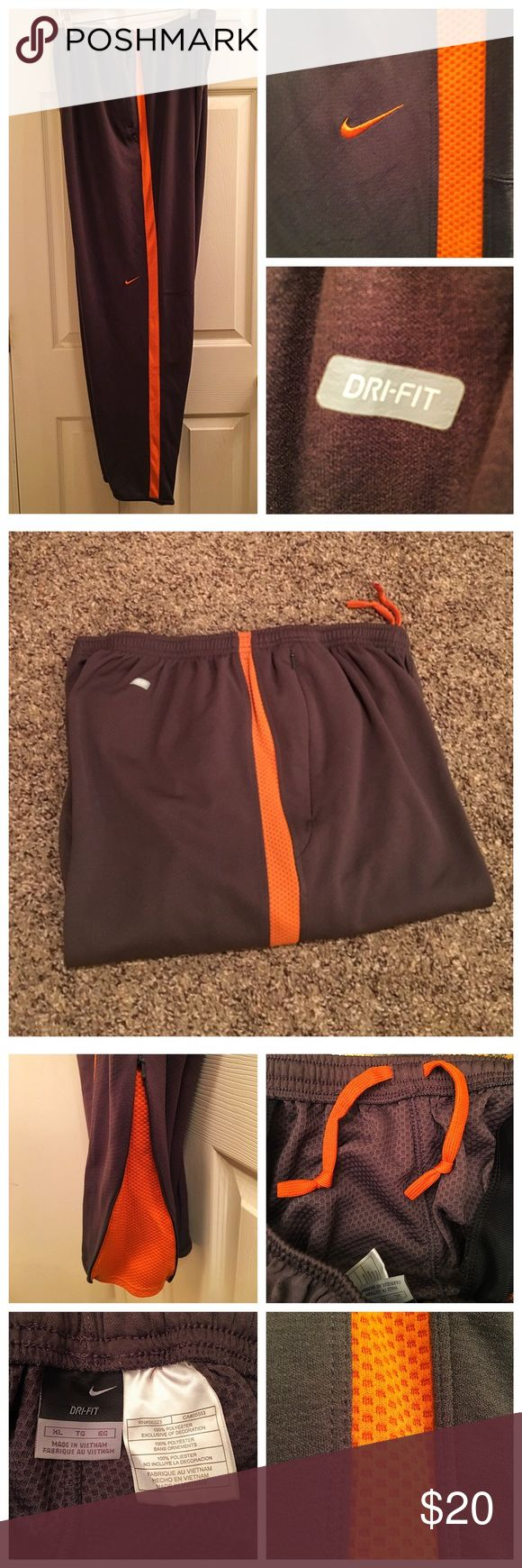 Nike Dri-Fit Men's Workout Pants Essential gym to street workout pants for men.  In stylish orange and brown color with zippered pockets and drawstring waist for comfort.  Leg bottoms also can be zippered open for extra legroom. Nike Dri-Fit Pants Sweatpants & Joggers
