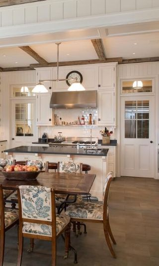 Quaint White Kitchen Open To The Dining Room