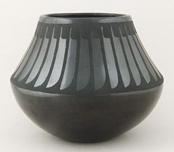 The famous black pottery of New Mexico comes from two pueblos, San Ildefonso and Santa Clara, two neighboring pueblo villages, laying along the Rio Grande river just north of Santa Fe.