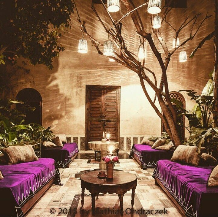 Courtyard with purple draped couches/ daybeds and lanterns | Morocco.                                                                                                                                                     More