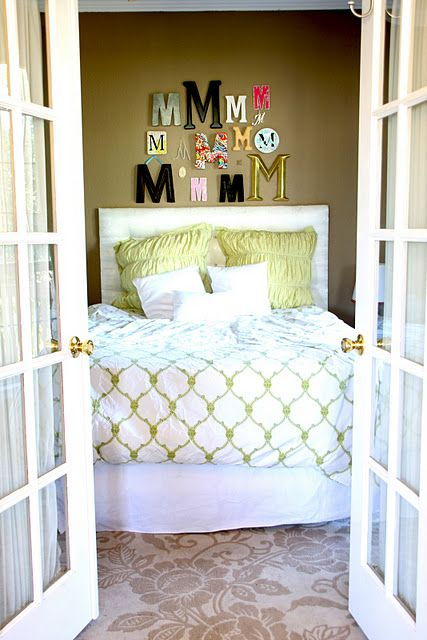 Collect initials, display above headboard.