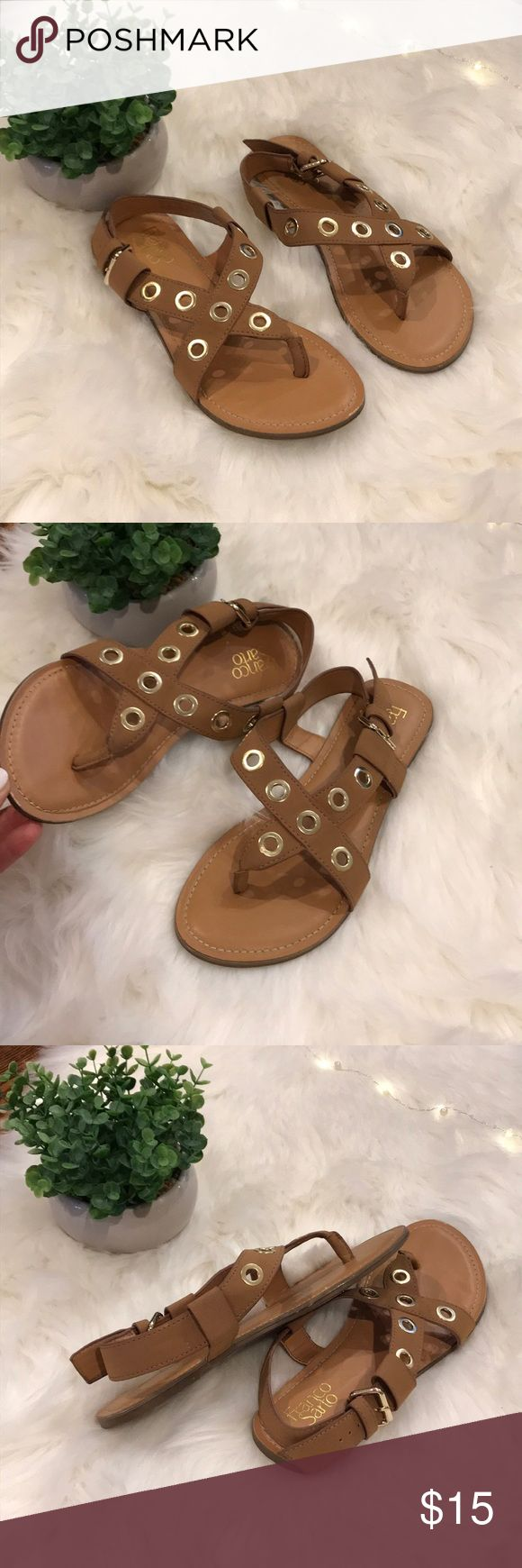 Franco Sarto Sandals Super cute sandals worn once. Tan Franco Sarto thongs with gold detail. The straps are asymmetrical and leave the inside of the foot more exposed. Size 8M Franco Sarto Shoes Sandals