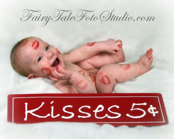 Baby covered in lipstick kisses kisses 5 cents sign valentines day portrait poses