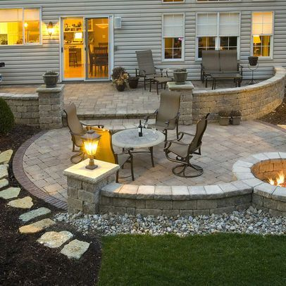 Tiered patio, top for dining, two lower on either side for fire pit and splash pad.