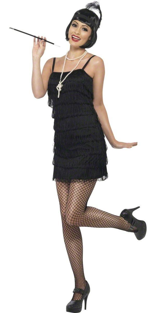 20-luvun Tytön lisukkeet. Peruukki, valkoinen helminauhakoru, sulkapantapäähine ja tupakanpidike.