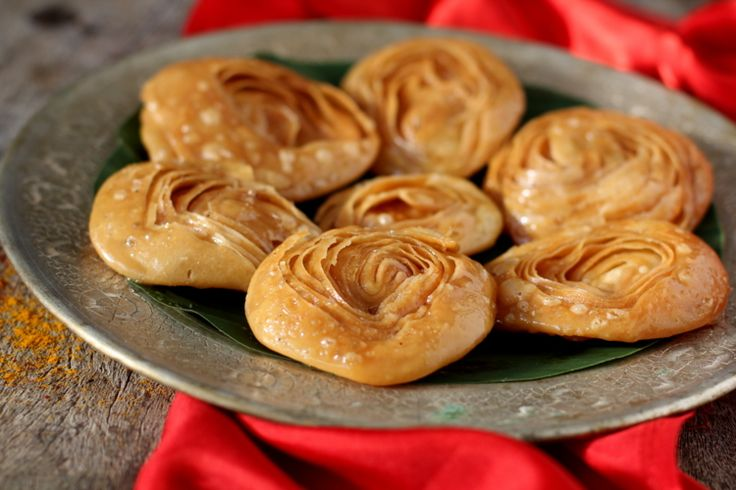 Chiroti recipe - one the best Indian sweets recipes made for weddings & festivals. A fried flaky pastry topped with powdered sugar or dipped in sugar syrup.