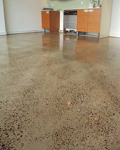 polished concrete floors. love the small pebbles that show.