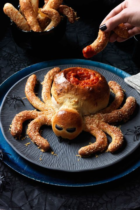 Saucy Spider Recipe: Spin a web of doughy deliciousness with this party-perfect Halloween appetizer. If you can't find pizza dough at your supermarket, try a local pizza parlor, which will likely sell you a fresh ball. For extra effect, sprinkle the legs with poppy seeds, in addition to Parmesan.