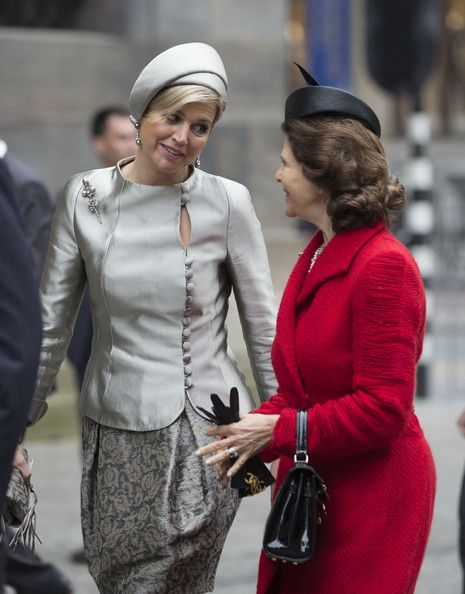 Queen Silvia of Sweden (R) Queen Maxima of The Netherlands walk at the start of an official two day visit to Holland on 4 April 2014 in Amsterdam, Netherlands.