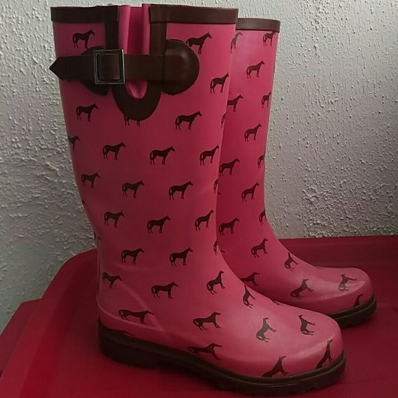 Pink rain boots with horse detailing Super cute rain boots for any horse lover! Signs of wear around the toe of each boot as well as on the inside. Shoes Winter & Rain Boots