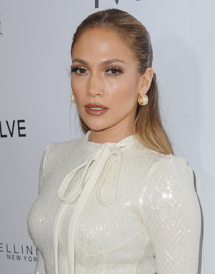 We're used to seeing Jennifer Lopez in supersexy red carpet attire, but she teased a more covered-up look at the Daily Front Row's Fashion Los Angeles Awards that was just as hot.