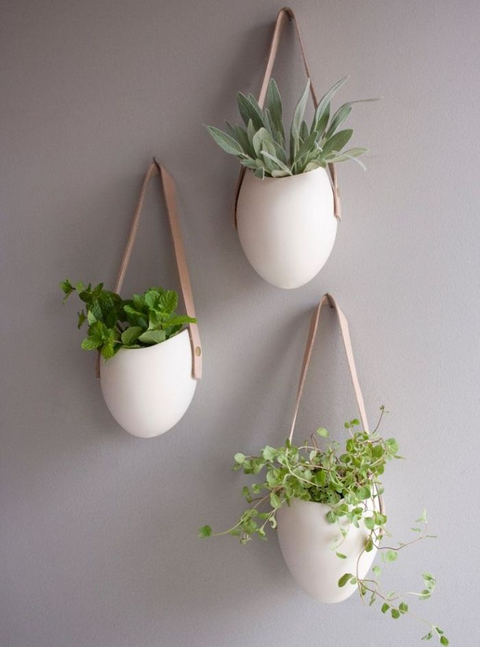 Create stunning hanging planters with leather straps. #DIY #leather #accessories