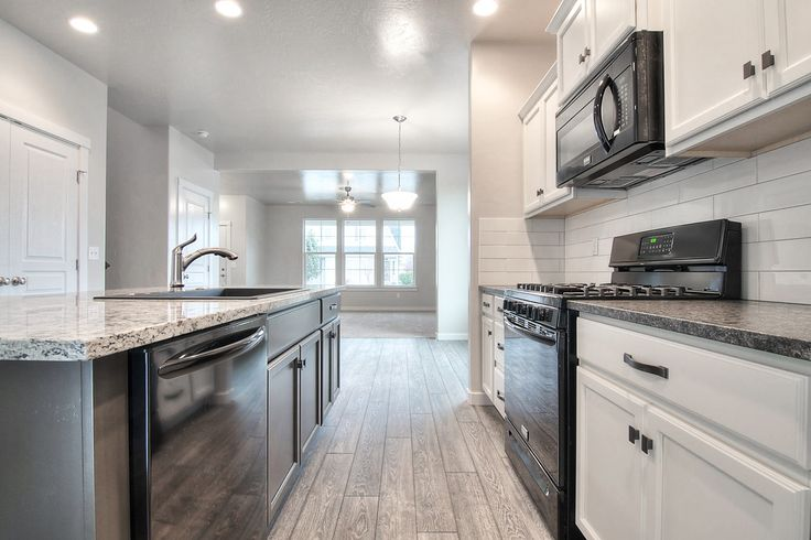 Head Over Heels For This Two Tone Kitchen! Ashen White Granite On Forest  Floor