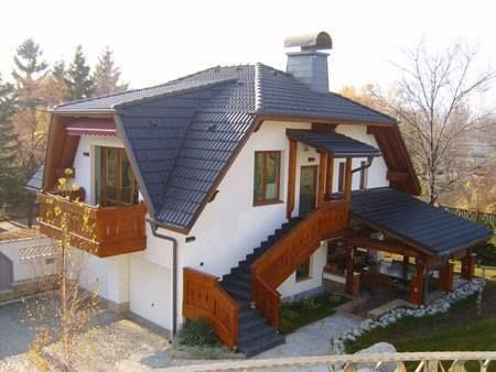 Casa cu acoperis cu forma neregulata